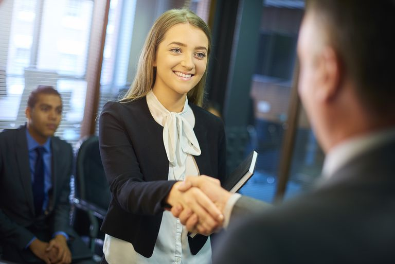 young-woman-shakes-hands-at-interview-599255630-589d261e3df78c4758bd6158.jpg