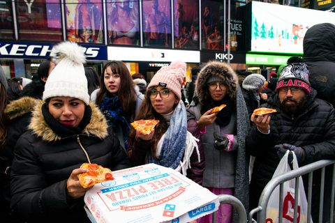 people-eat-pizza-as-they-arrive-to-celebrate-new-years-eve-news-photo-1577981090.jpg