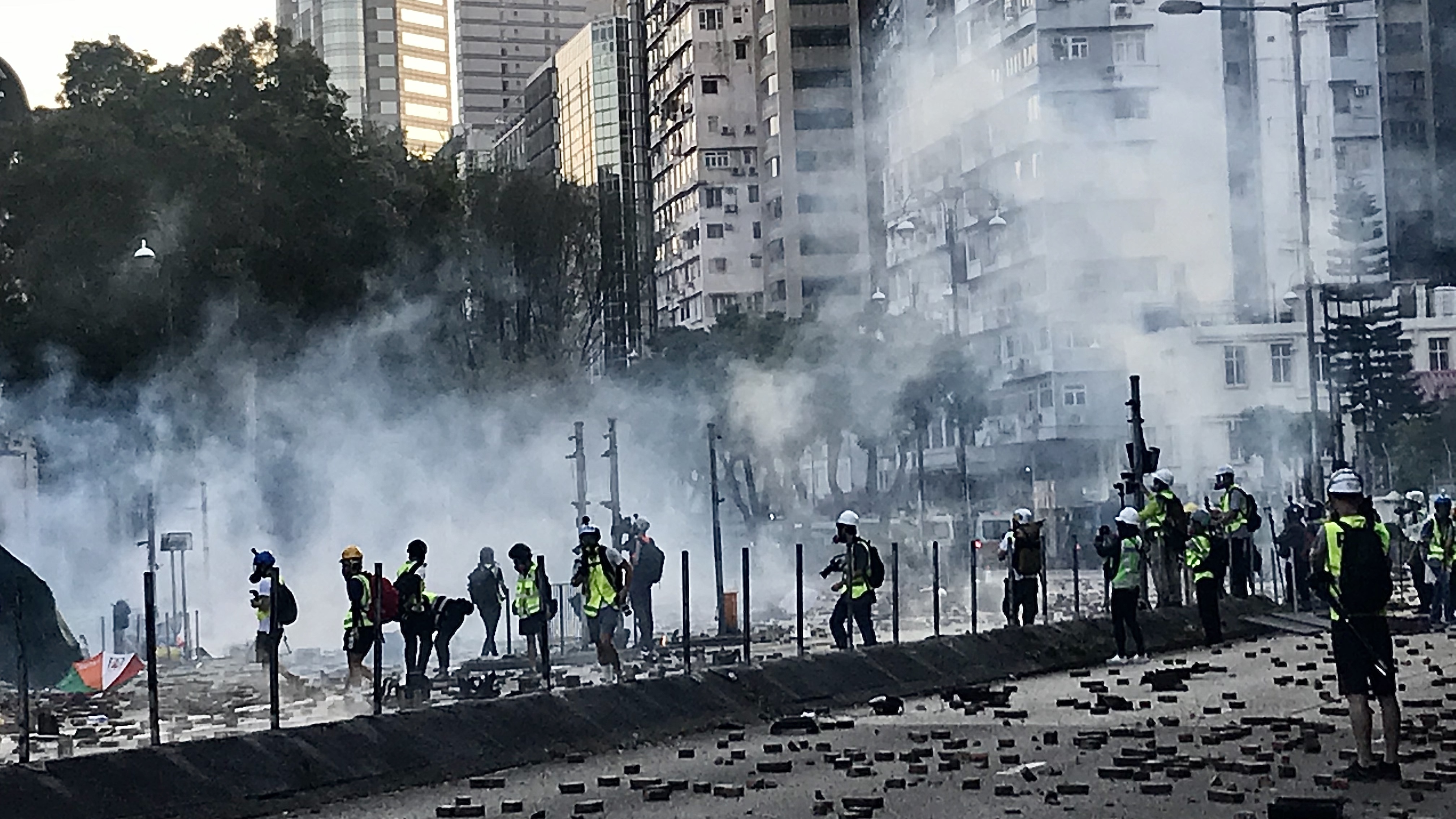 journalists-getting-caught-in-between-the-frontline-protesters-and-hong-kong-police-as-canisters-of-teargas-are-fired_wide-895a3070102138b481b092a4bd4b54d8c6ed69e9.jpg